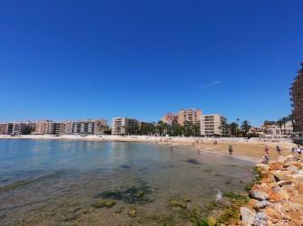 Playa de los Locos - Playa de los Locos - Vistas de la playa desde el norte, que conecta con la zona rocosa de la punta del Salaret.